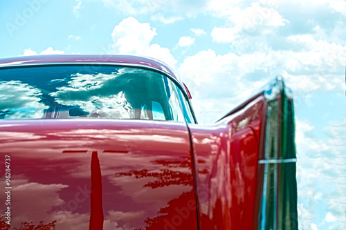 Keuken foto achterwand Vintage cars Red classic car with sky background