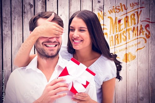 Fotografering  Composite image of woman surprising boyfriend with gift