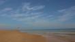 Adult man walking on the beach. Sea, sky and sand, tropical beach
