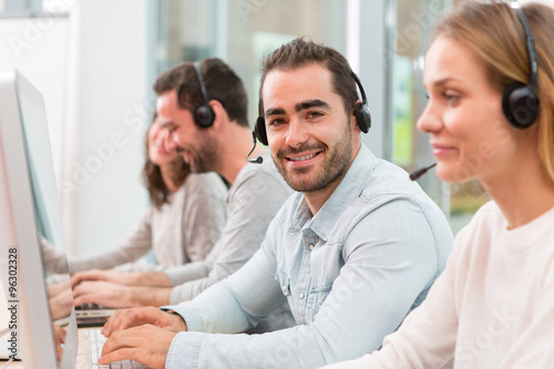 Fototapety, obrazy: Young attractive man working in a call center