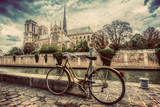 Fototapeta Paris - Retro bike next to Notre Dame Cathedral in Paris, France. Vintage