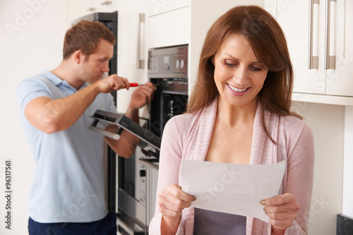 Smiling Woman With Repair Bill