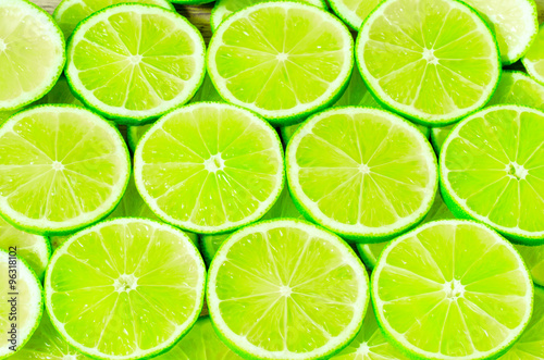 Fotografia  Lime slices background
