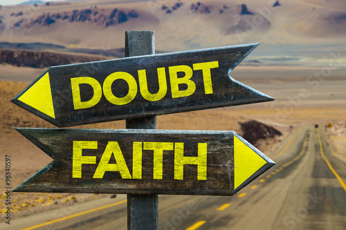 Doubt - Faith signpost in a desert road on background Canvas Print