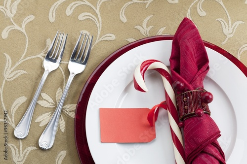 Photo  dining table with candy cane and forks