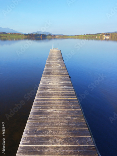 Jetty on lake Hopfensee in Bavaria