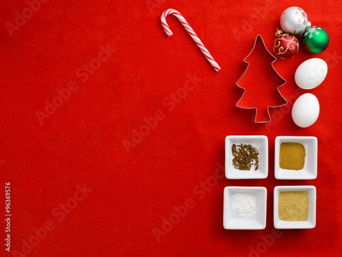 Fototapety, obrazy: top view of cake ingredient with cookie cutter with christmas bu