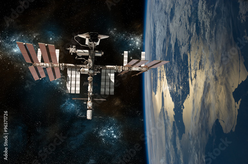 Keuken foto achterwand Nasa The International Space Station Orbiting Earth with the space shuttle docked. - - Elements of this Image Furnished by NASA.