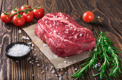Raw marbled meat steak Ribeye on dark wooden background Fotobehang