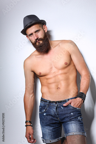 Deurstickers Akt Portrait of handsome bearded man in hat standing , isolated on grey background
