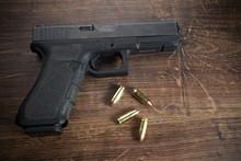 Pistol Gun On Wooden Background
