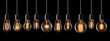 canvas print picture - Set of vintage glowing light bulbs on black background
