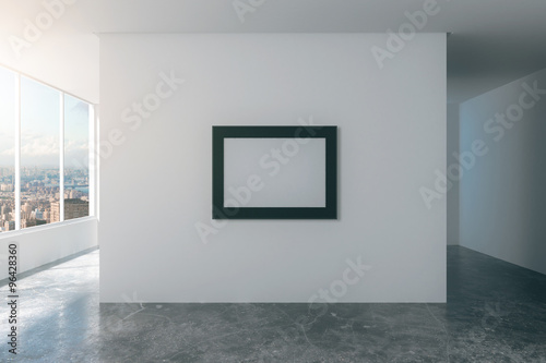 dc327f664e3 Blank picture frame on white wall in empty loft style room with ...