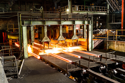 hot steel on conveyor in steel mill Tableau sur Toile