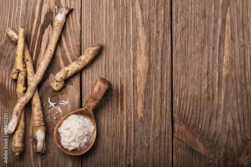 Fotografie, Obraz  Seasoning of grated horseradish with space for text