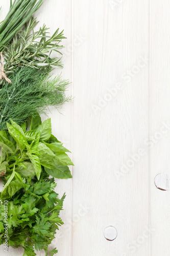 Fototapeta Fresh garden herbs on wooden table obraz