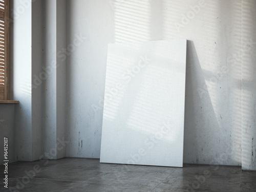 Fototapeta Blank white canvas in the bright loft interior. obraz na płótnie