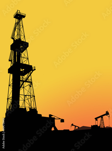 Silhouette of drilling rig on the oil&gas field with