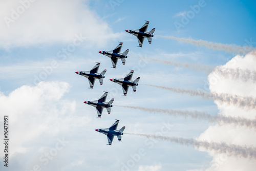 Fotografering  USAF F-16 Thunderbirds Flying Above the Clouds