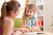 Mother or teacher woman helping child with homework