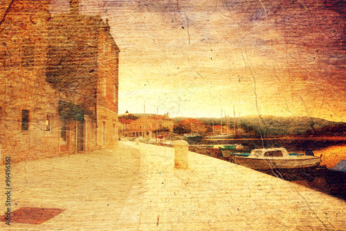 Spoed Foto op Canvas Stad aan het water empty quay of mediterranean town Starji Grad at sunset (Croatia, Hvar). Picture in artistic retro style.
