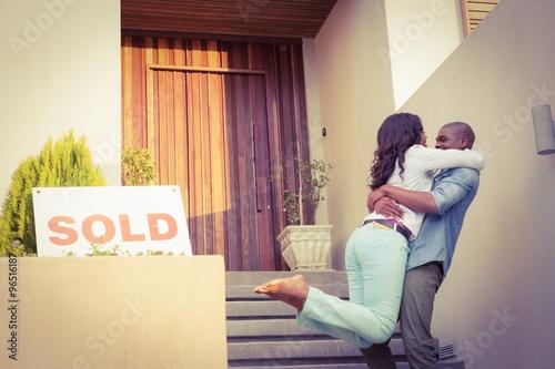 Fényképezés  Happy couple after buying new house