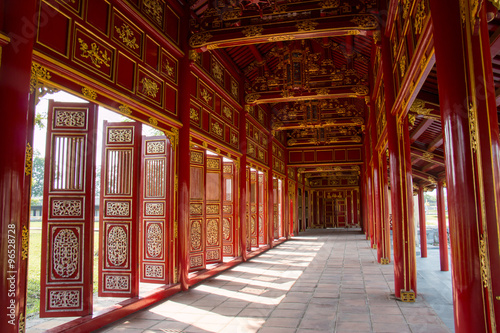 Canvas Prints Artistic monument Red shutters and doors in the citadel of Hue, Vietnam