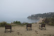 Three empty chairs in the coast