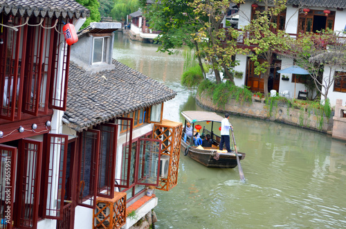 Old village by river in Shanghai with boat.. Poster