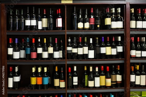 View of row bottles of wine Canvas Print