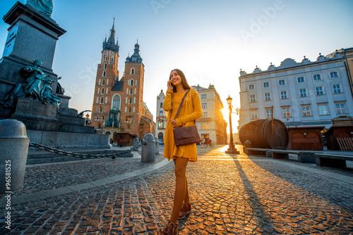 Fototapeta Woman walking in the old city center of Krakow  obraz