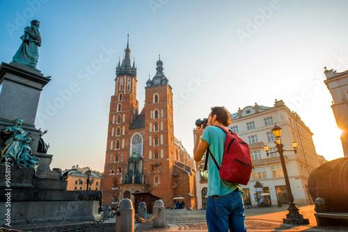 Fototapeta Tourist photographing in the center of Krakow obraz
