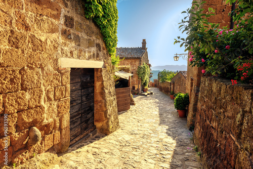 Canvas Prints Narrow alley Sunny narrows on a summer day in an old Italian town