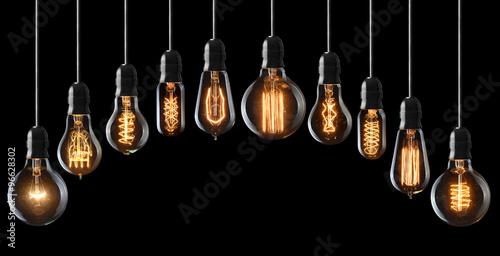 Photo  Set of vintage glowing light bulbs on black
