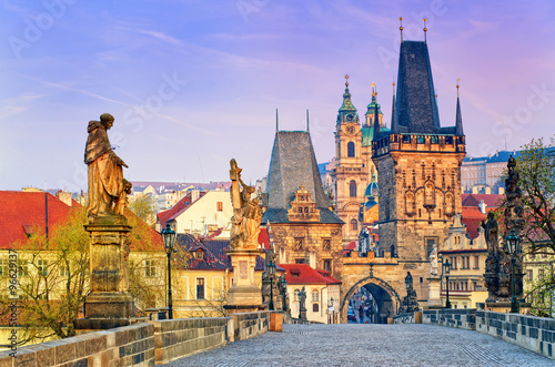 Prague Charles Bridge and the towers of the old town of Prague on sunrise, Czech Republic