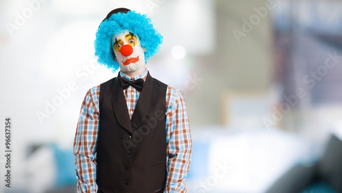 Photo  portrait of a funny clown over white