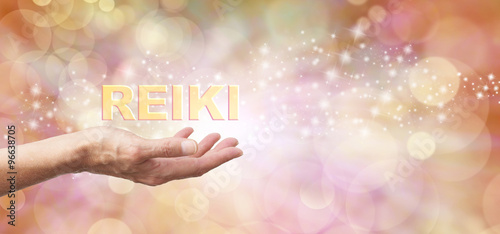 Photo  Golden Reiki Healing Energy Share    - Female with outstretched hand palm facing