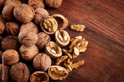 Keuken foto achterwand Baobab Walnuts whole in their skins, chopped, nut hulls, walnut kernels