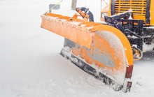 Snow Plow Doing Snow Removal After A Blizzard In Chicago Suberb.