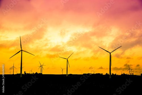Fotografie, Obraz  Wind farm at sunset, Alternative energy concept, instagram style retro processin