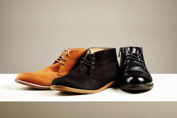 a lot of men's shoes.fashion still life men boots