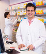 Pharmacist and assistant working