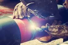 Welding Pipes On A Constructio...