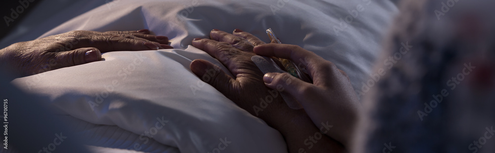Fototapeta Person assisting dying hospice patient