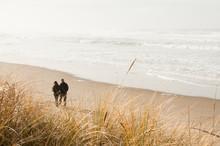 Misty Morning Stroll On A Sandy Beach. Copy Space.