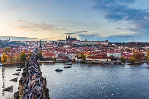 Fotobehang Praag Scenic summer evening panorama of the Old Town architecture with Vltava river, Charles Bridge and St.Vitus Cathedral in Prague, Czech Republic