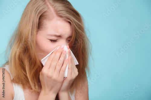 Flu allergy. Sick girl sneezing in tissue. Health Wallpaper Mural