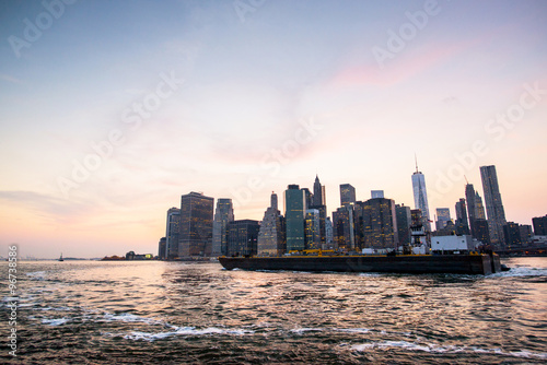 tanker in front of new-york city during the sunset Poster