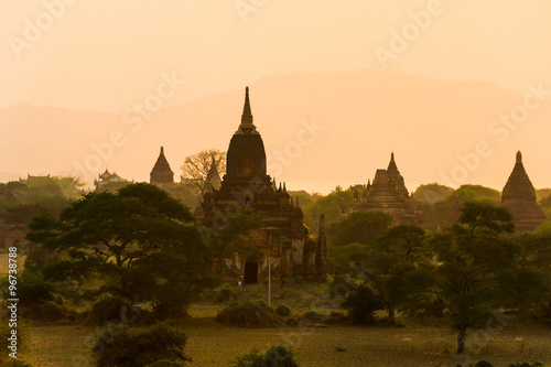 Garden Poster Light pink Sunset in Bagan, Myanmar. Bagan is ancient city with thousands of ancient temples in Myanmar.