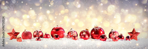 Vintage Christmas Baubles On Snow With Golden Lights